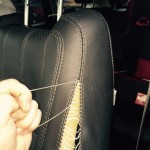 Black Car Seat Stitching During Repair